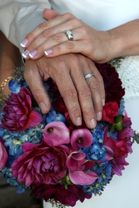 Merd hands on bouquet fuchsia pink callas dahlia blue hydrangea